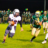 Ayer Shirley quarterback Steven Lawton scrambles as he is chased by Clinton's Dylan Neeley. Nashoba Valley Voice/Ed Niser
