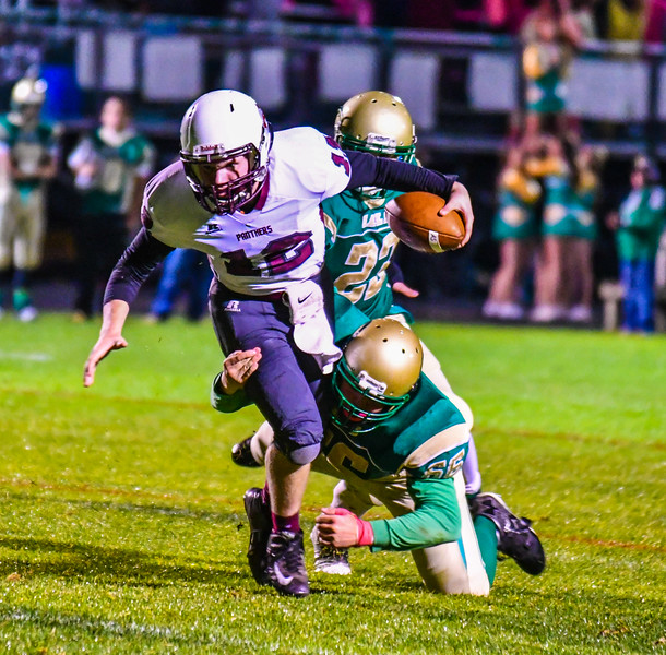 Ayer Shirley quarterback Steven Lawton is tackled by Clinton's Devin LePerle. Nashoba Valley Voice/Ed Niser
