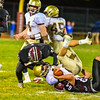 From left, Groton-Dunstable's Kenneth Pollard and Dillon Eberhardt converge for a tackle. Nashoba Valley Voice/Ed Niser
