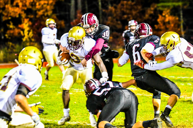 Groton-Dunstable's Eddie Hastings hits Shepherd Hill running back Kevin Mensah in the first half of Friday's game. Nashoba Valley Voice/Ed Niser