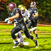 Groton-Dunstable senior running back Logan Higgins slips a Shepherd Hill defender during Friday night's loss. Nashoba Valley Voice/Ed Niser