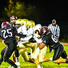 Groton-Dunstable's Dillon Eberhardt makes a tackle during Friday night's loss to Shepherd Hill. Nashoba Valley Voice/Ed Niser
