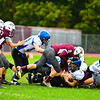 Lucas Sargent finishes off a tackle during Saturdays loss. Nashoba Valley Voice/Ed Niser