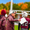Ayer Shirley head coach Phil Marchegiani relays the play call to his quarterback Steven Lawton on the sideline. Nashoba Valley Voice/Ed Niser