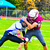 Ayer Shirley running back Jimmy Robinson tries to shed a tackle. Nashoba Valley Voice/Ed Niser