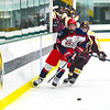 North Middlesex's Matt DeVito chases the puck during Monday night's loss. Nashoba Valley Voice/Ed Niser