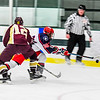 North Middlesex's Cameron Stairs knocks down the puck during Monday's loss to Algonquin. Nashoba Valley Voice/Ed Niser