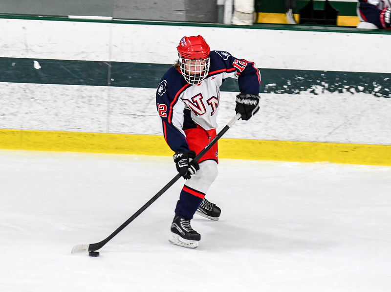 North Middlesex sophomore Trent Costa skates with the puck during Monday's loss to Algonquin. Nashoba Valley Voice/Ed Niser