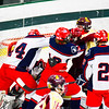 North Middlesex and Algonquin players battle in front of the net during Monday night's game at the Wallace Civic Center. Nashoba Valley Voice/Ed Niser