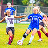Lunenburg's Emma Houston gains possession of the ball from Ayer Shirley's Taryn Manna. Nashoba Valley Voice/Ed Niser