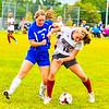 Ayer Shirley's Anna Norton battles makes a tackle on Lunenburg's Ashley Powell. Nashoba Valley Voice/Ed Niser