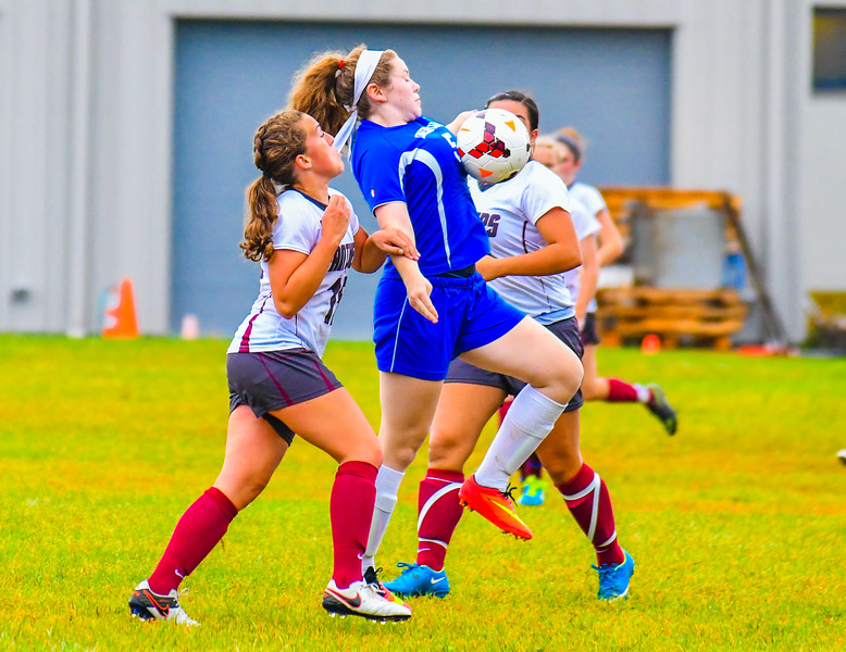 Lunenburg's Judith Swift maintains control of the ball at the midfield while defended by Ayer Shirley's Ariana Cambridge. Nashoba Valley Voice/Ed Niser