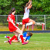 North Middlesex's Erin Bourgeous leaps over the Hudson goalie after taking a shot. Nashoba Valley Voice/Ed Niser