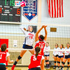 North MIddlesex junior middle hitter Madeline Harrington sizes up a spike during Tuesday's match. Nashoba Valley Voice/Ed Niser