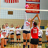 North Middlesex senior co-captain Ashley Osborne spikes the ball during Tuesday's win over Hudson. Nashoba Valley Voice/Ed NIser
