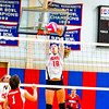North Middlesex middle hitter Madeline Harrington blocks a shot during Tuesday's match. Nashoba Valley Voice/Ed Niser