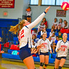 North Middlesex setter Sarah Ward spikes the ball during Tuesday's win over Hudson. Nashoba Valley Voice/Ed Niser
