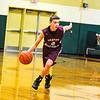 Groton-Dunstable freshman guard Evan Cook takes the ball up the floor during Tuesday's loss at Nashoba. Nashoba Valley Voice/Ed Niser