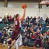 Groton-Dunstable senior Shane Dawson drives to the basket during Tuesday's lossat Nashoba. Nashoba Valley Voice/Ed Niser
