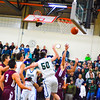 Groton-Dunstable senior Danny Howes puts up a shot in traffic during Tuesday night's loss to Nashoba Regional. Nashoba Valley Voice/Ed Niser
