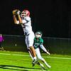 2- Fitchburg senior wide receiver CJ Byars hauls in a 30-yard touchdown pass over Oakmont senior Evan Bourque. Sentinel & Enterprise/Ed Niser