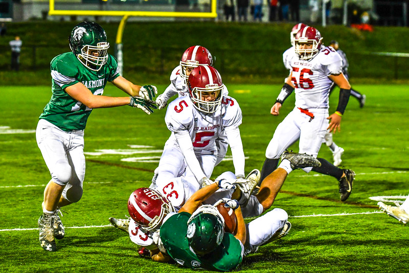 Fitchburg's Mike Nowd and Alex Marrero converge for a tackle. Sentinel & Enterprise/Ed Niser