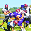 Groton-Dunstable's Dillon Eberhardt (right) and Ryan TeDuits make a tackle during Saturday's loss. Nashoba Valley Voice/Ed Niser