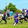 Groton-Dunstable's Cam Battles makes a tackle. Nashoba Valley Voice/Ed Niser