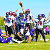 Groton-Dunstable's Shamus Gelinas rises from the pile with the ball after recovering a fumble in the opening half of Saturday's game. Nashoba Valley Voice/Ed Niser