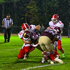 North Middlesex's Alex Hollenback records the stop on Tomahawk running back Zach Smith. Nashoba Valley Voice/Ed Niser