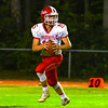 North Middlesex quarterback Joe Haskins drops back to pass during Friday night's loss. Nashoba Valley Voice/Ed Niser