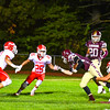 Algonquin's Brett Sherman is wrapped up by North Middlesex's Alex Hollenback, while Tim O'Neill and Xavier Marty close in. Nashoba Valley Voice/Ed NIser
