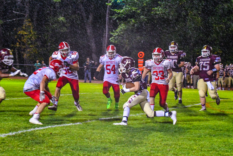 From left, North Middlesex's Jake Hachey, Alex Hollenback, Cam Meservey and Noah Lowthers converge on Algonquin running back Zach Smith in the third quarter of Friday's loss. Nashoba Valley Voice/Ed Niser