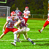 North Middlesex's Jake Hachey sizes up Algonquin ball carrier Jack Hill. Nashoba Valley Voice/Ed Niser