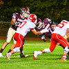 North Middlesex's Tim O'Neill wraps up Algonquin's Ben Sherman during Friday's loss. Nashoba Valley Voice/Ed Niser