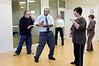 Tony Burton, Tai Chi instructor, leads a class in the Heritage Shores Fitness Center.