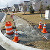 This corner of Canvasback and Heritage Shores Dr. will have a completed sidewalk soon.