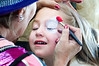 Easter Sunday Brunch -- with many children able to have their face painted and see the Easter Bunny.  Danielle, 4,  gets a face done by Sandy Johnson of the Sunshine Entertainment  Company 410-749-0904