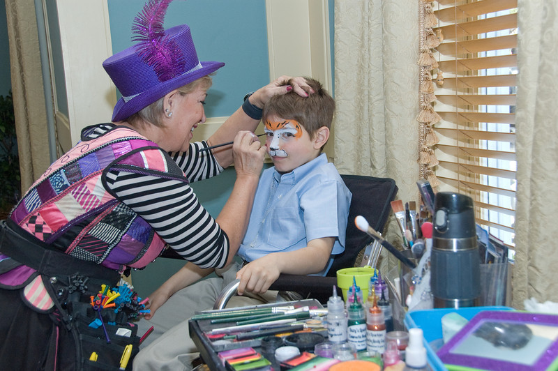 Easter Sunday Brunch -- with many children able to have their face painted and see the Easter Bunny.  Connor Rennert gets a face done by Sandy Johnson of the Sunshine Entertainment  Company - 410-749-0904