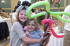 Easter Sunday Brunch -- with many children able to have their face painted and see the Easter Bunny.  Debbie on staff at Heritage Shores Club gets into the fun of things.  Sydney with little sister Kennedy enjoy themselves.