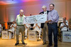US Navy Band Commodores.  Left to right are Phil Clark, John Barr and Richard Walzak of Honor Flight Philadelphia.  John and Phil present a check for $1,000 to Richard during concert.