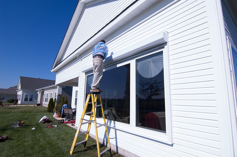 Ellen Tassone and husband, Lawrence, have installed a hurrican shutter on their home located on emily's Pintail