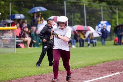 JOSH KAUFMANN, St. Albans Messenger Dani Russin sprints home with BFA-Fairfax's first run in Thursday's rainy Division II softball quarterfinal. Russin had four hits, three steals and three runs in the Bullets' 23rd straight win, 15-10 over Mt. Abraham.