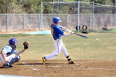 BEN KAUFMANN, St. Albans Messenger Luke Covey drives the ball for one of his three hits in the Yellowjackets' opening-game baseball victory at South Burlington on Saturday. Covey had three hits, scored four runs and stole two bases in the 7-6 win.