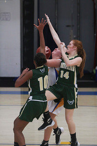 JOSH KAUFMANN, St. Albans Messenger Mary Curran (14) and Azwayla Taylor block a shot by Milton's Cassidy Button on Saturday.