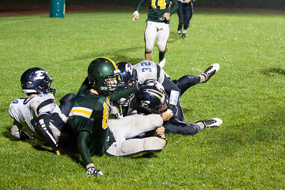 JOSH KAUFMANN, St. Albans Messenger Essex defensive back Joseph Robertson cradles the football for a game-sealing interception after he wrestled the ball away from BFA receiver Matt Sanders (80) on a last-minute pass by BFA-St. Albans on Friday night.