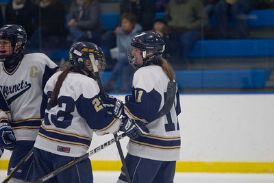 JOSH KAUFMANN, St. Albans Messenger Melanie Theriault (11) celebrates with Tiffany Barnes after giving Essex a two-goal lead in the second period against Missisquoi on Saturday. MVU came back to earn a 3-3 tie when Katie Campbell scored her third of the day with nine-tenths of a second left in the third period.