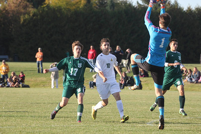 BEN KAUFMANN, St. Albans Messenger Alex Grismore of BFA-St. Albans watches St. Johnsbury keeper Linus Nygard make a save during the Hilltoppers' 3-2 soccer win Wednesday.