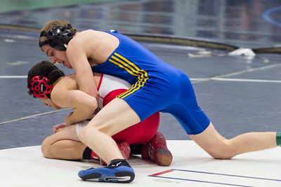 JOSH KAUFMANN, St. Albans Messenger Milton's Dylan Hemsted wrestles Saturday morning in the Michael Baker Tournament at Essex H.S.