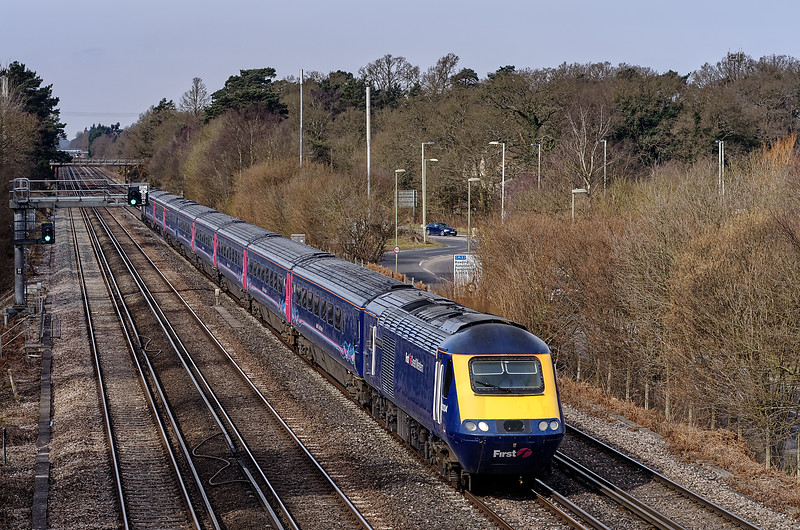 43034 / 43137 running between Fleet and Farnborough with 1O36, <br /> the 07:53 Exeter - Waterloo, on 7th April 2013.